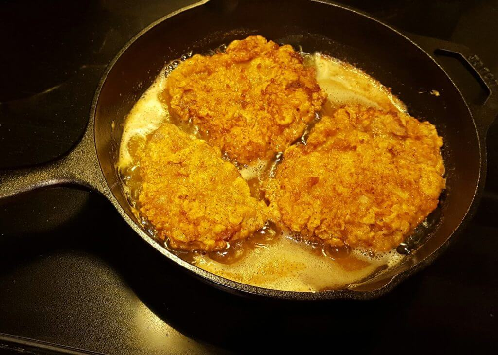 iron skillet frying pork