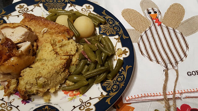 Southern Cornbread dressing or stuffing on a blue and white china plate