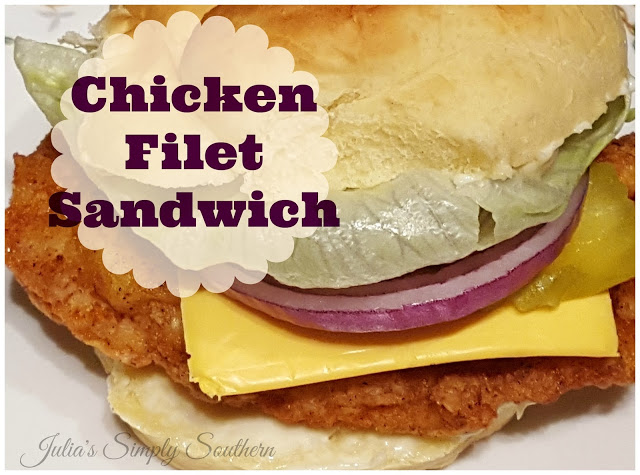 Fried Chicken Breast Cutlet Sandwich with cheese and red onion