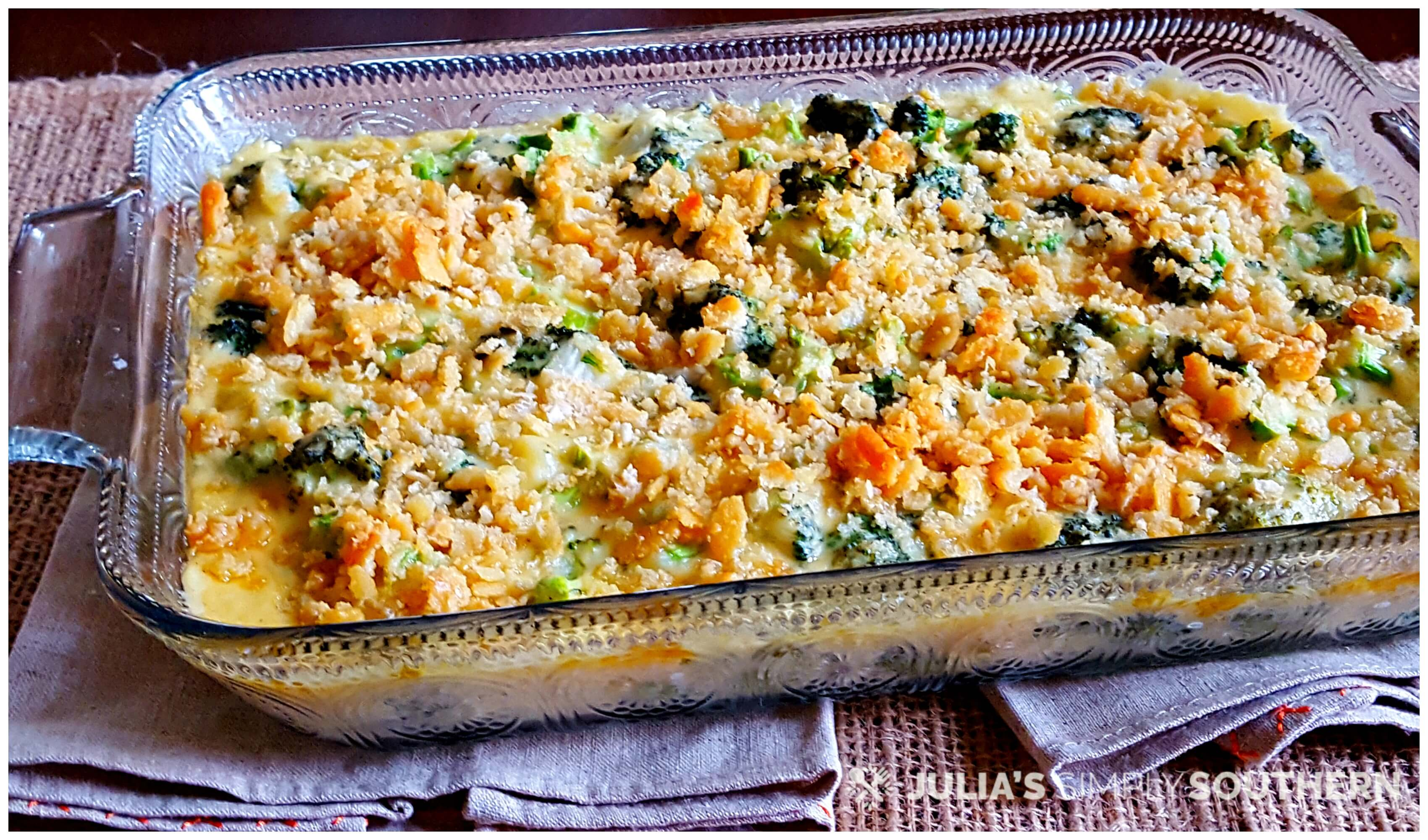 Glass casserole dish with baked broccoli and cheese topped with Ritz