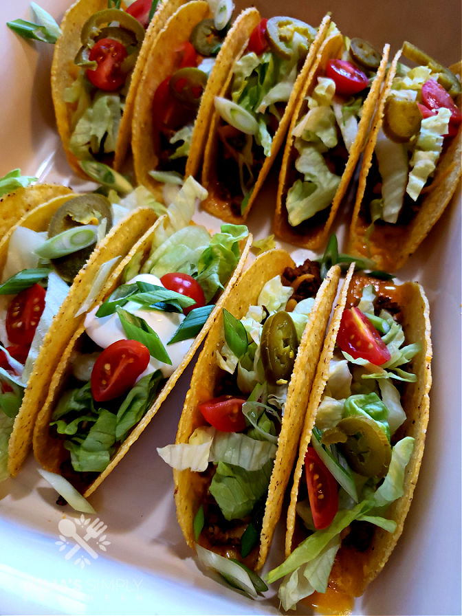Baked Hard Shell Tacos - family favorite meals for Taco Tuesday - tacos with toppings in this easy cheesy oven baked tacos recipe