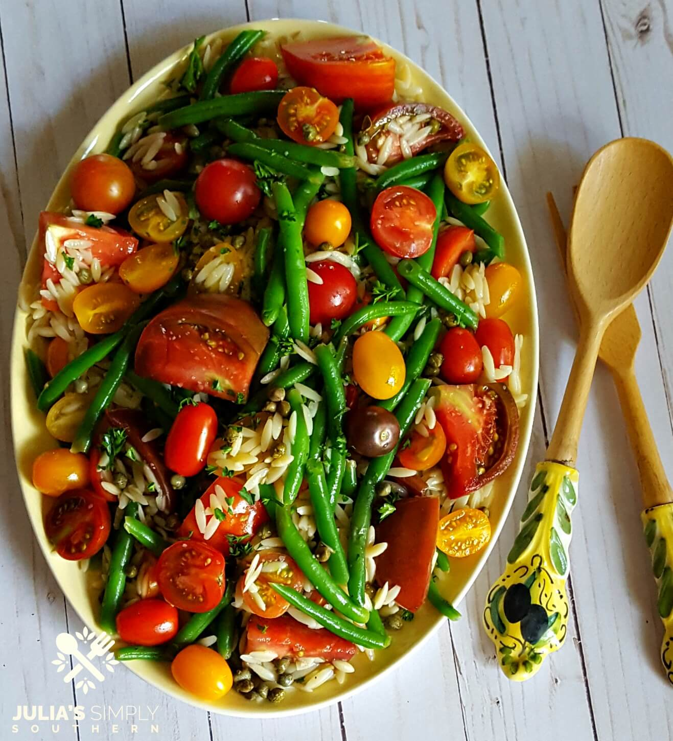 Colorful tomato and green bean salad side dish