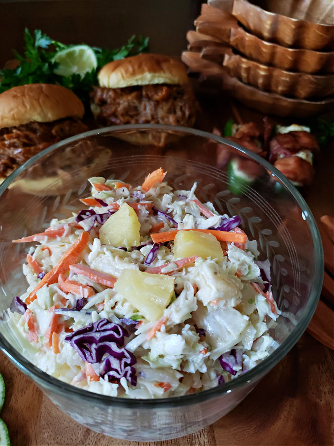 Pineapple Coleslaw summer side dish in a crystal serving bowl