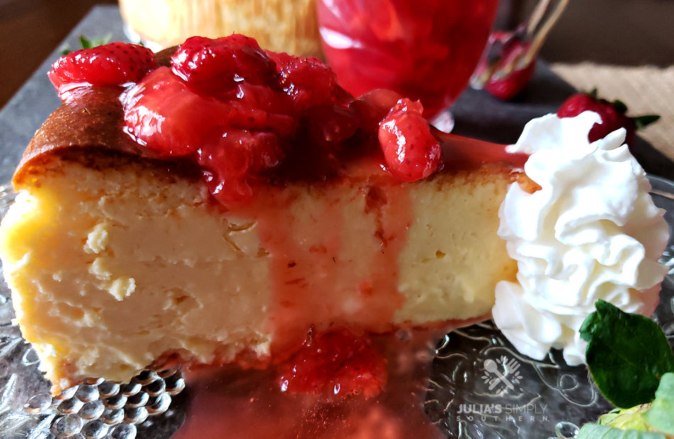 Homemade Martha Steward Cheesecake Recipe with Fresh strawberry topping and whipped cream like cheesecake factory on a serving plate