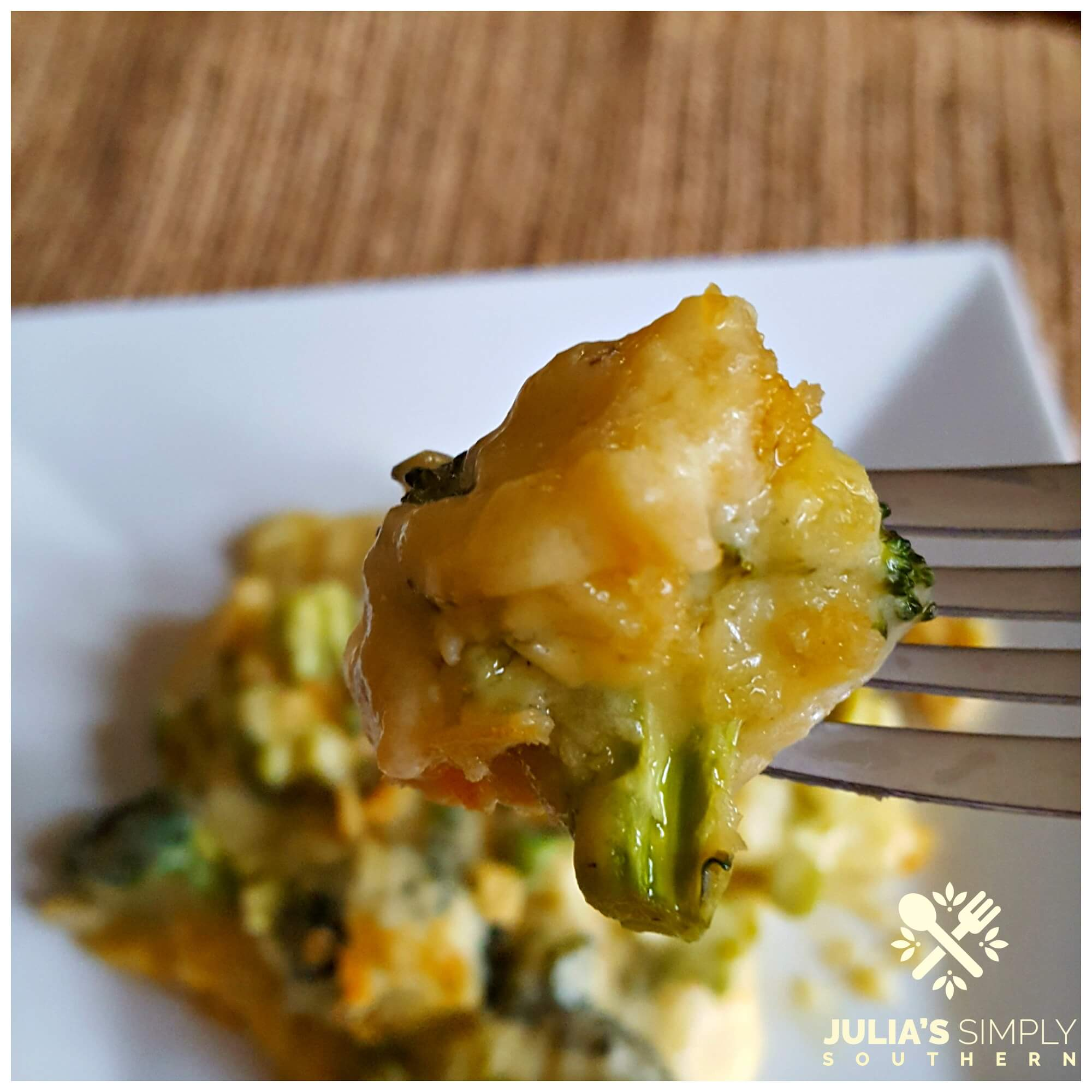 Broccoli and cheese on a white plate