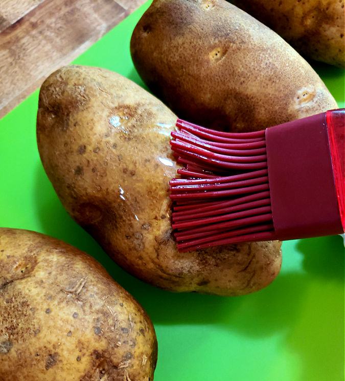 brush potatoes with oil before baking