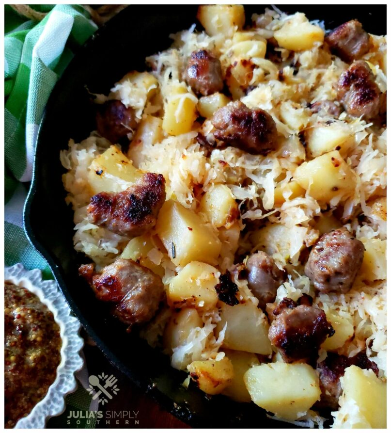 Bratwurst Potatoes and Sauerkraut Skillet Meal with a side of brown grain mustard