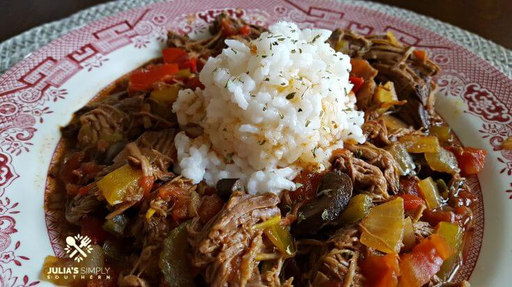 Crock Pot Fiesta Beef on a red and white china plate with rice