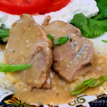 Crock Pot Pork Roast with Gravy on a bed of mashed potatoes with a cottage cheese salad