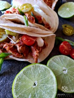 Easy Crock Pot Chicken Tacos Recipe in soft flour tortillas with favorite taco toppings
