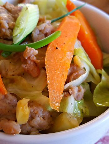 Low Carb Pork, Cabbage and Carrot Stir Fry on red and white china