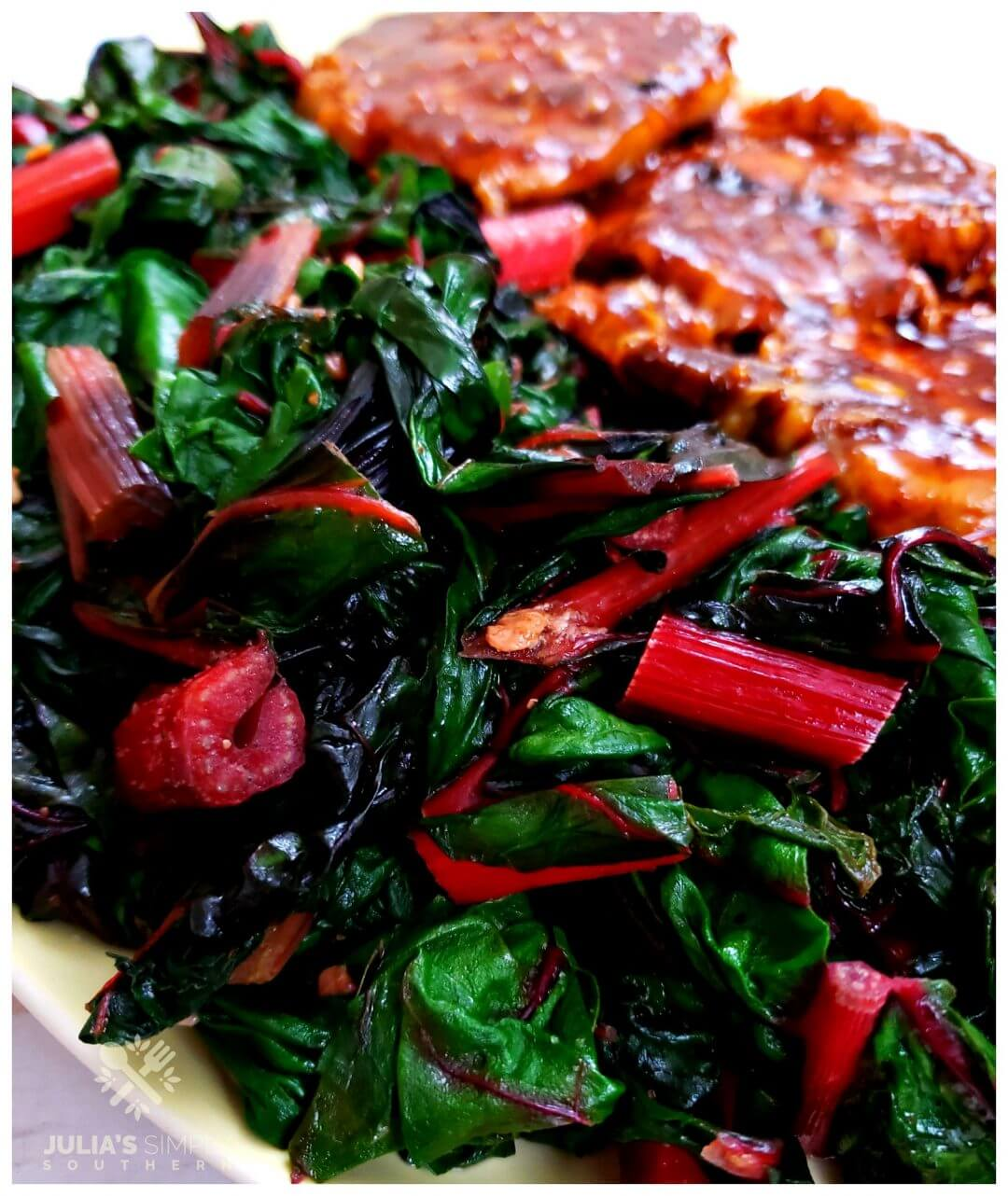 Amazing Swiss Chard Recipe - easy and healthy vegetable side dish, pictured on a platter with pork chops