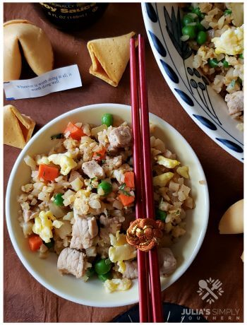 Low Carb Cauli Pork Fried Rice in a bowl with chopsticks and fortune cookies - Easy Recipe