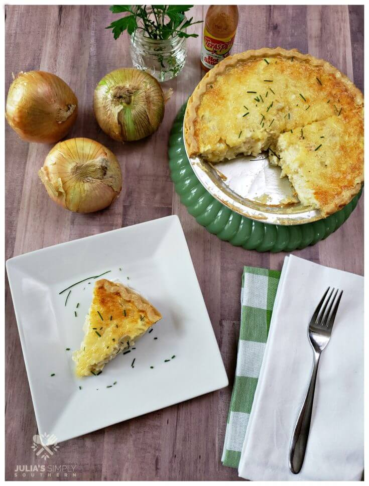 Old school onion pie with Vidalia onions and swiss cheese on a jade pie dish - green glassware