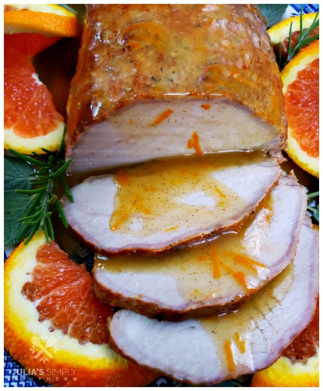 Easy oven roasted marinated pork roast with a fresh spiced orange sauce. This easy recipe is served on a platter garnished with fresh orange slices and topped with the orange sauce.