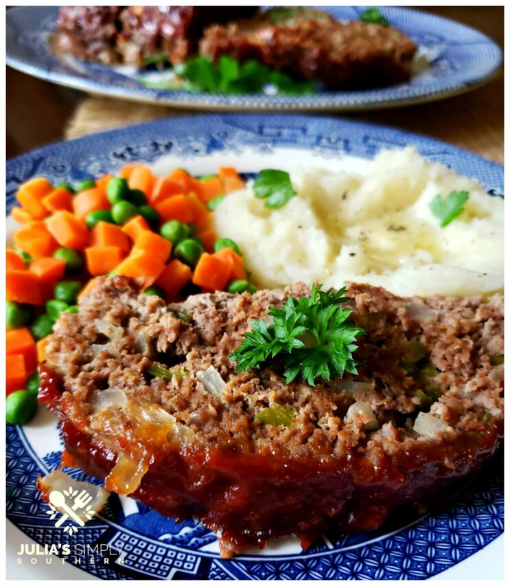 Classic Southern Meatloaf Recipe on a blue and white plate with mashed potatoes and peas and carrots