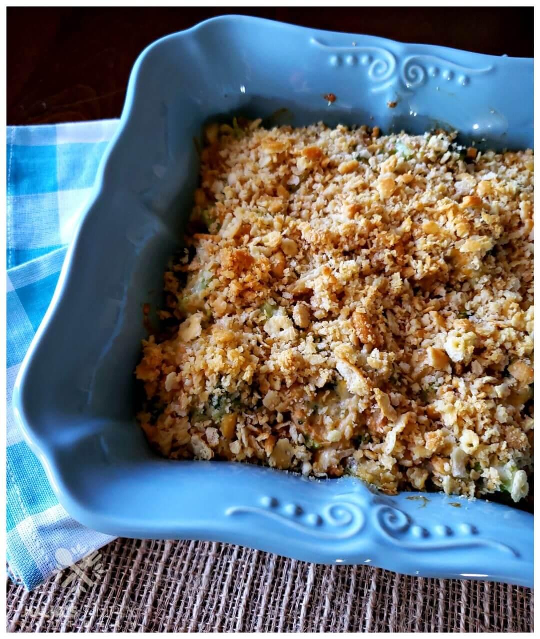 Classic Broccoli Casserole Recipe with Ritz Crackers in a square teal casserole dish