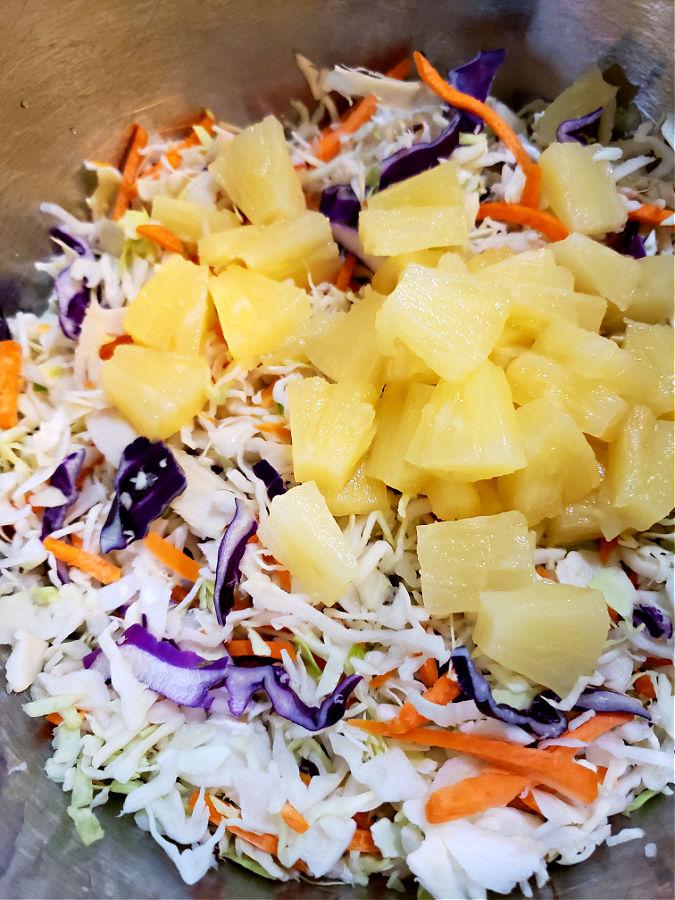 preparing a cabbage salad summer side dish