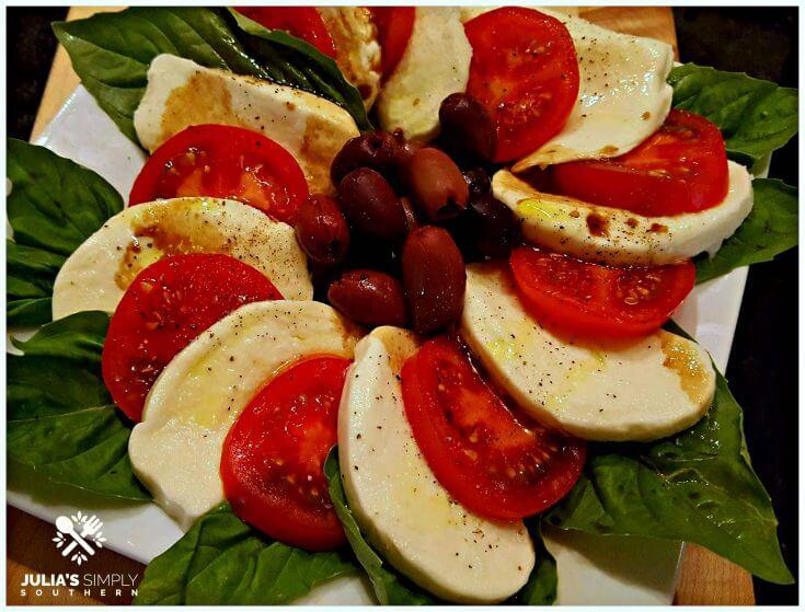 simple caprese salad with tomatoes mozzarella basil