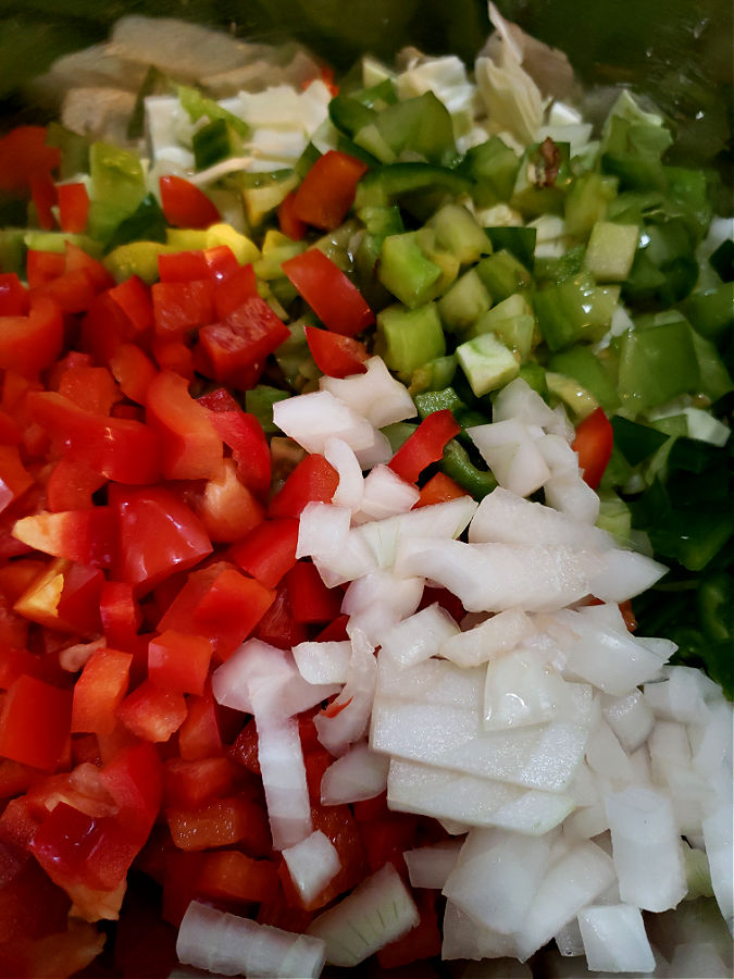 Chopped vegetables in a large mixing bowl