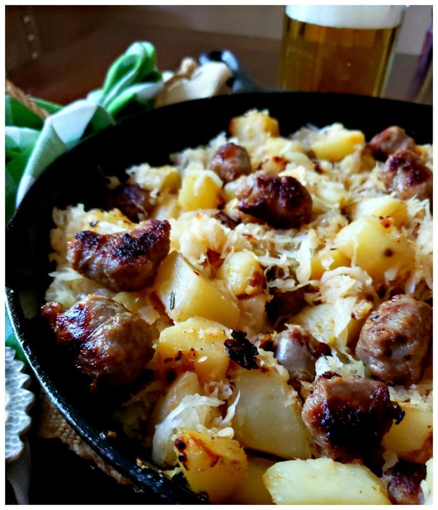 sausage and potato skillet dinner with a mug of beer
