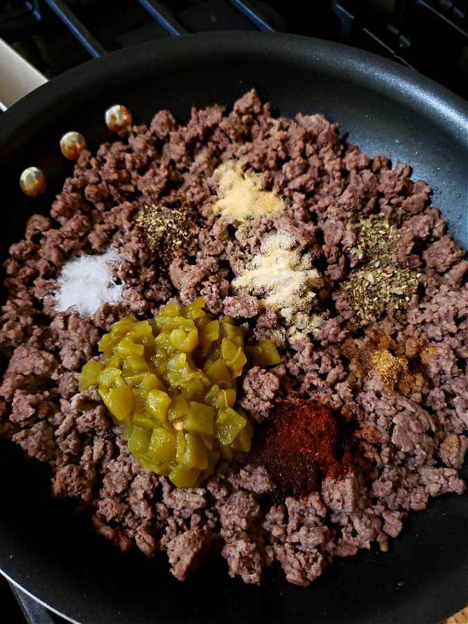 Cooked minced ground beef with Mexican cuisine seasonings and green chili peppers