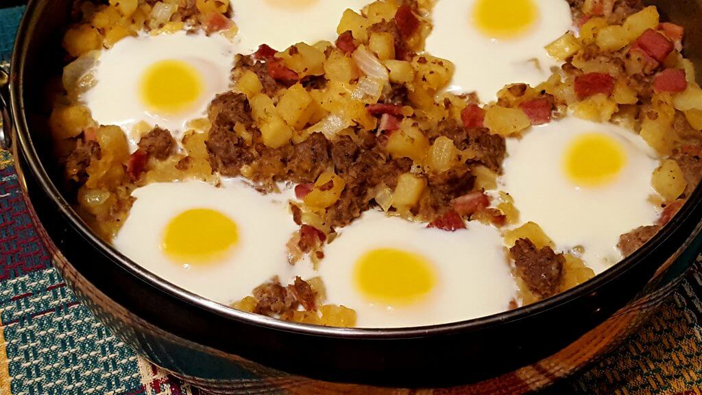 Large skillet with country breakfast hash with eggs