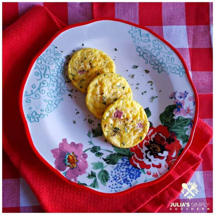 Easy Ham and Cheese Egg Muffins on a floral plate sitting on red and white linens
