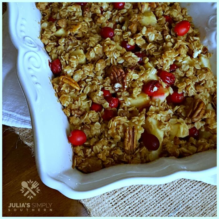 Cran apple bake for the holidays in a white scalloped baking dish - crisp