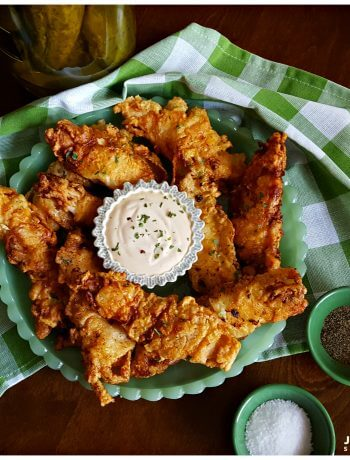 Dill Pickle Fried Chicken on a green jadeite glassware platter