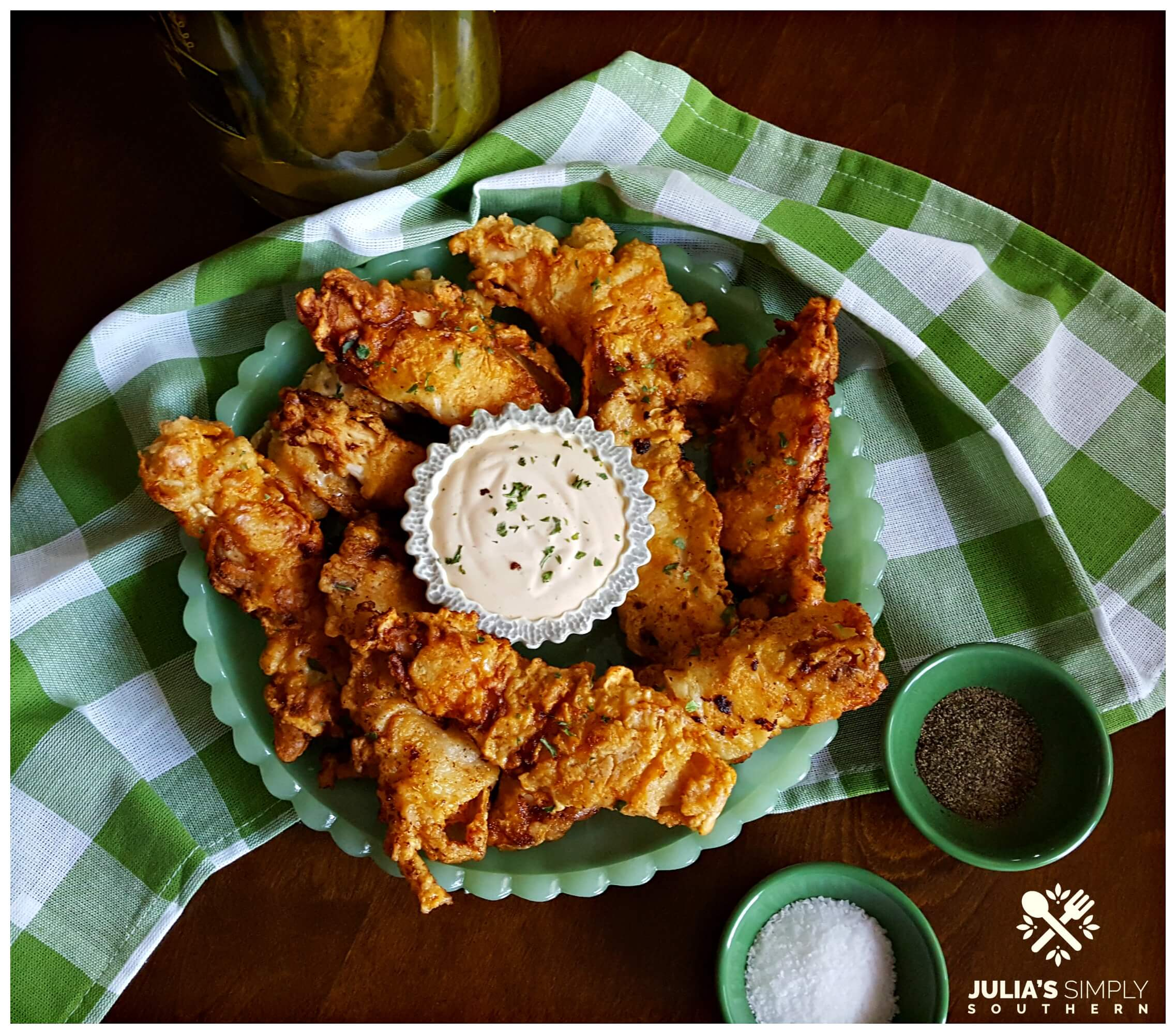 Dill Pickle Fried Chicken on a green jadeite glassware platter