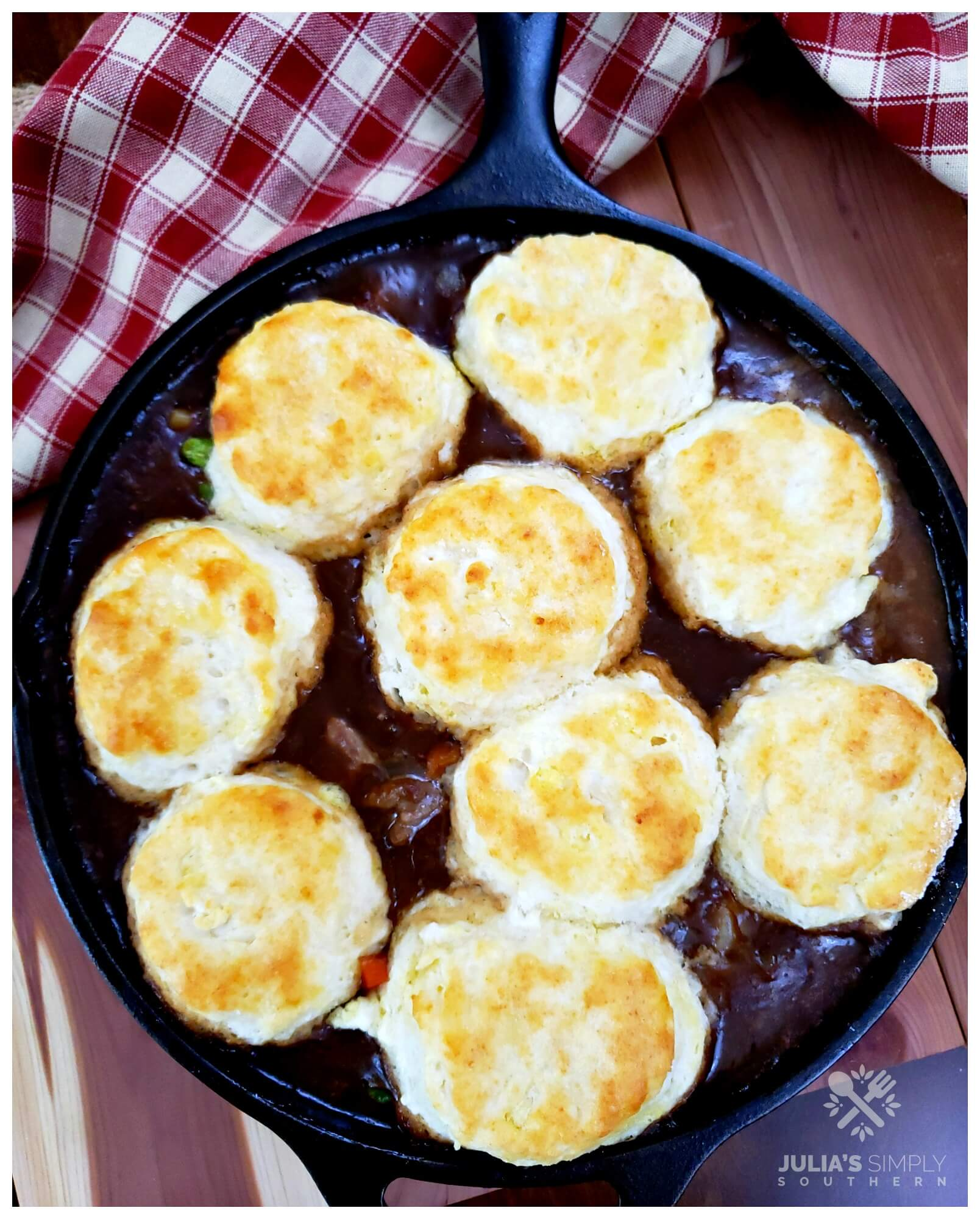 Beautiful one skillet pot pie meal, made with beef and vegetables then topped with biscuits before baking