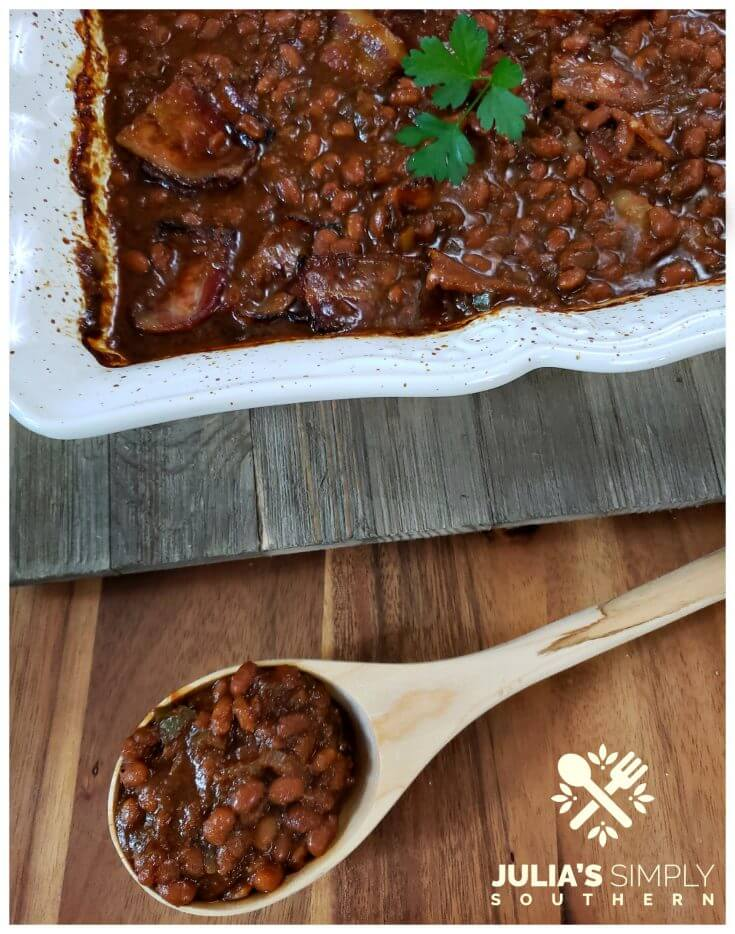 Grandma's Southern Style baked beans with molasses in a white casserole dish. This is a favorite side dish of summer and so easy to prepare.