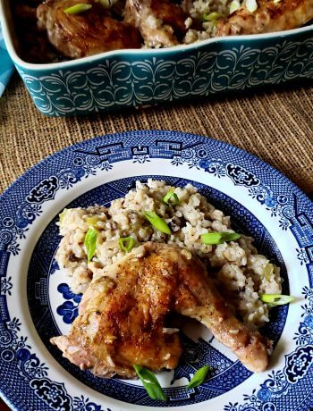 Delicious baked chicken and rice casserole serving on a Blue Willow plate