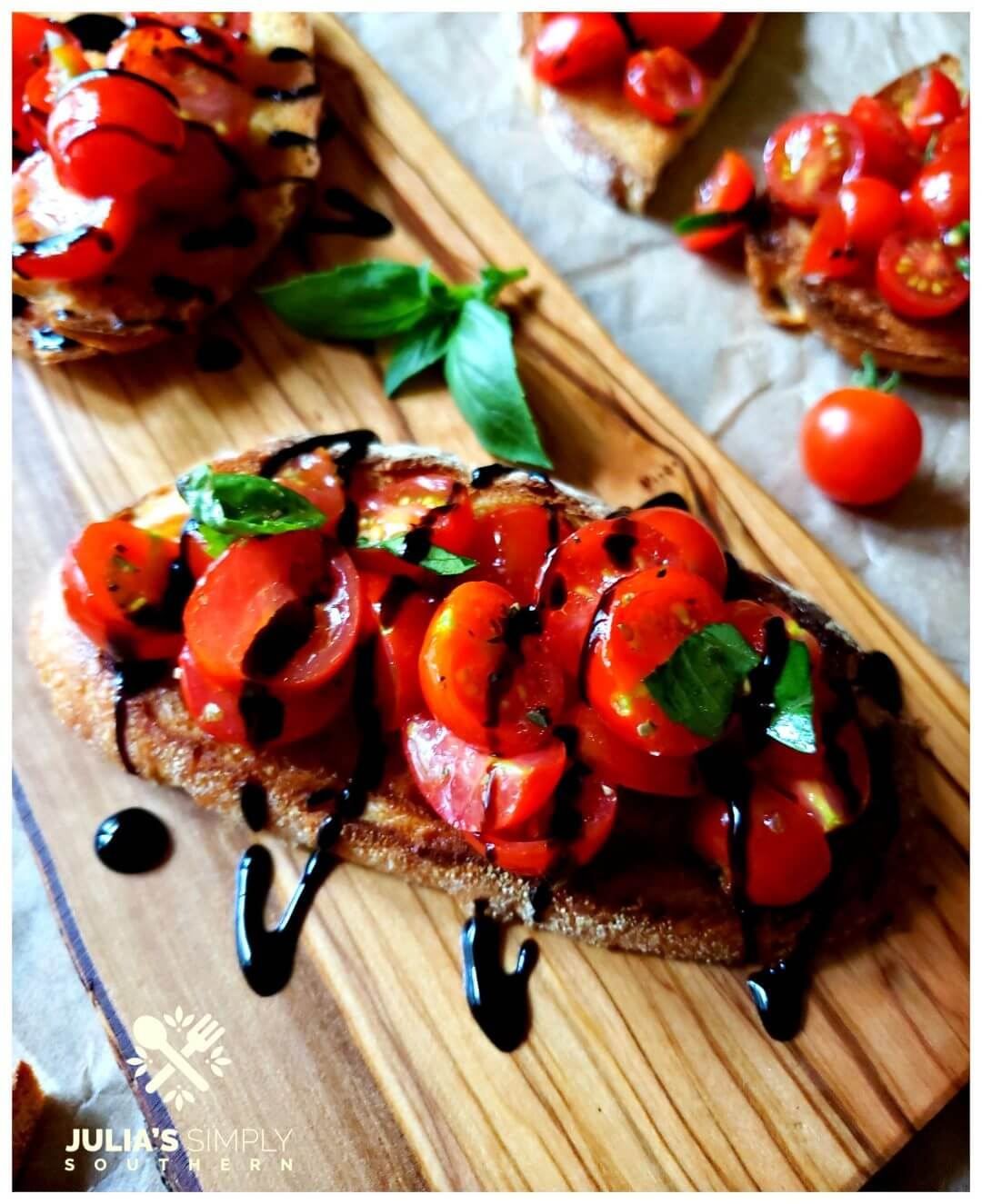 Recipe for Bruschetta made with tomatoes from the garden, herbs and garlic on toasted Italian bread with a balsamic glaze drizzle