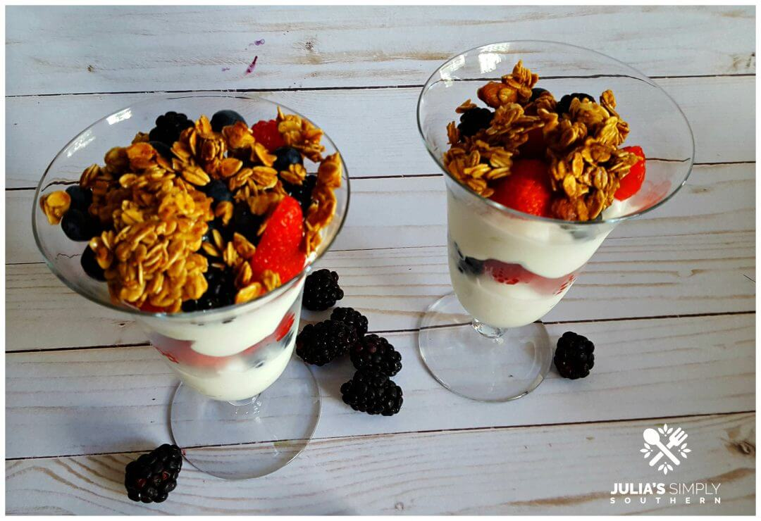 Recipe for fruit parfaits - served in parfait glasses using fresh fruit, yogurt and granola - Julia's Simply Southern
