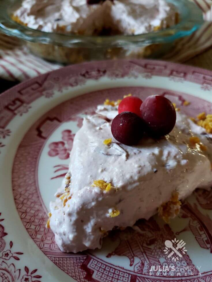 Frosty Cranberry Pie on a plate garnished with fresh cranberries