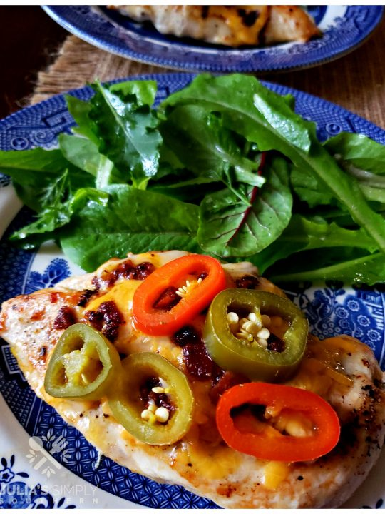 Jalapeno Popper Chicken Breast dinner with side salad on a blue and white Churchill plate