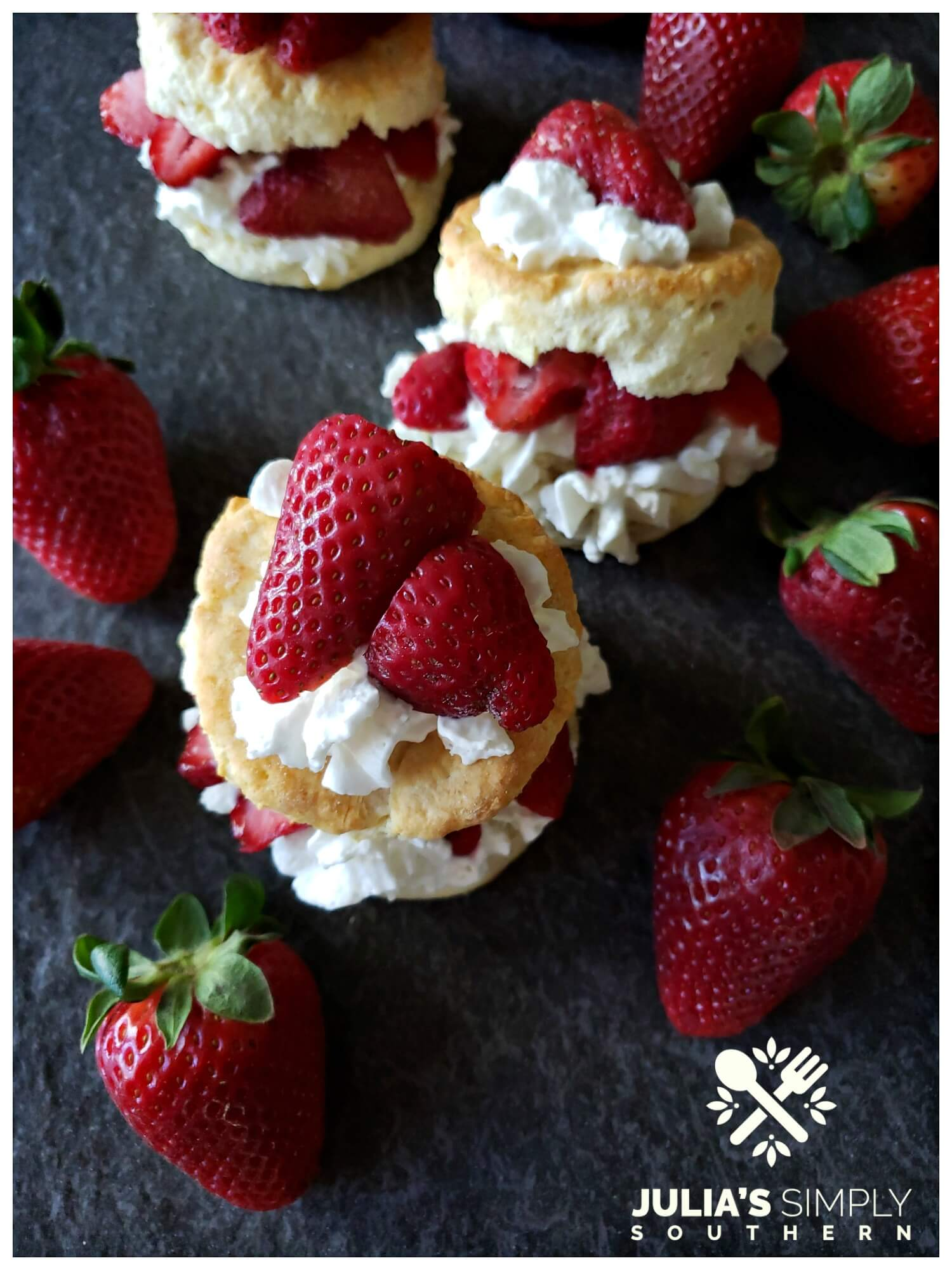 Traditional old fashioned strawberry shortcakes with fresh spring strawberries with whipped cream