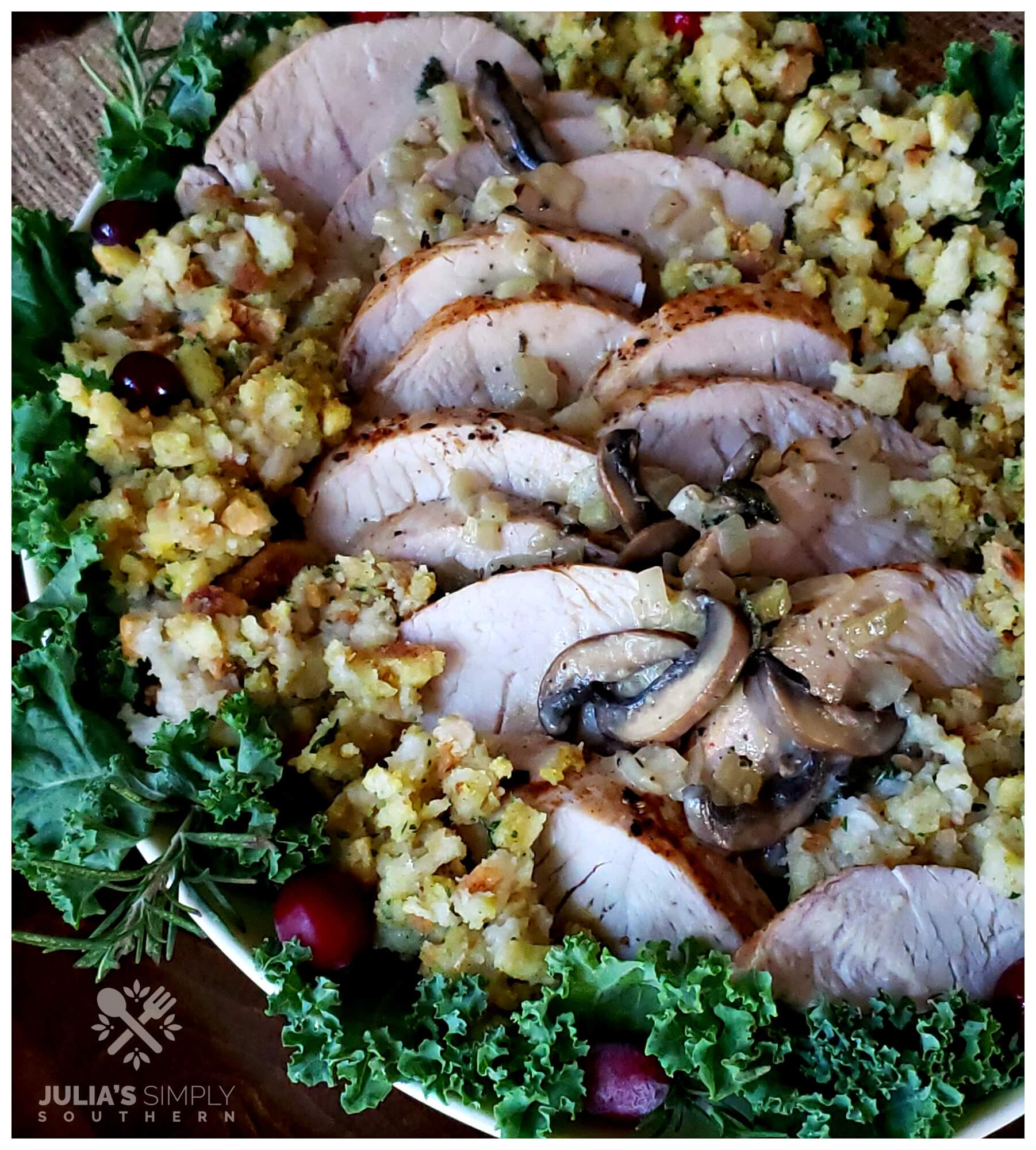 Platter with turkey and stuffing garnished with greenery and cranberries