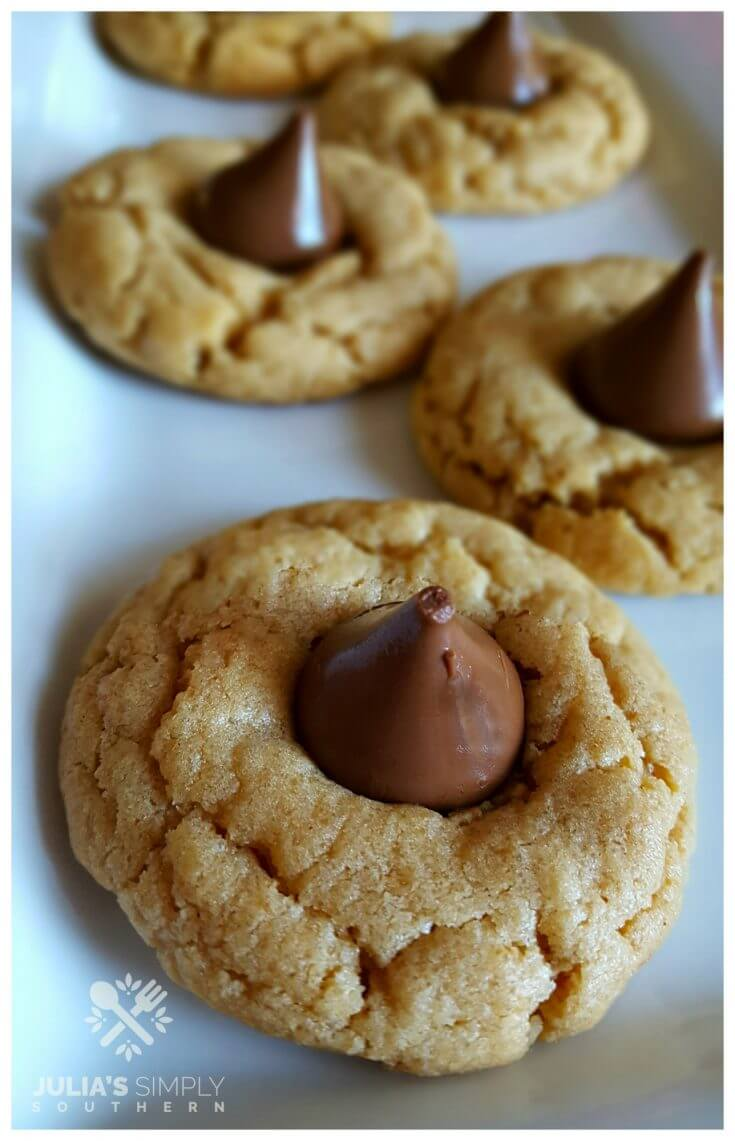 Peanut butter and Hershey Kiss cookies on a white platter