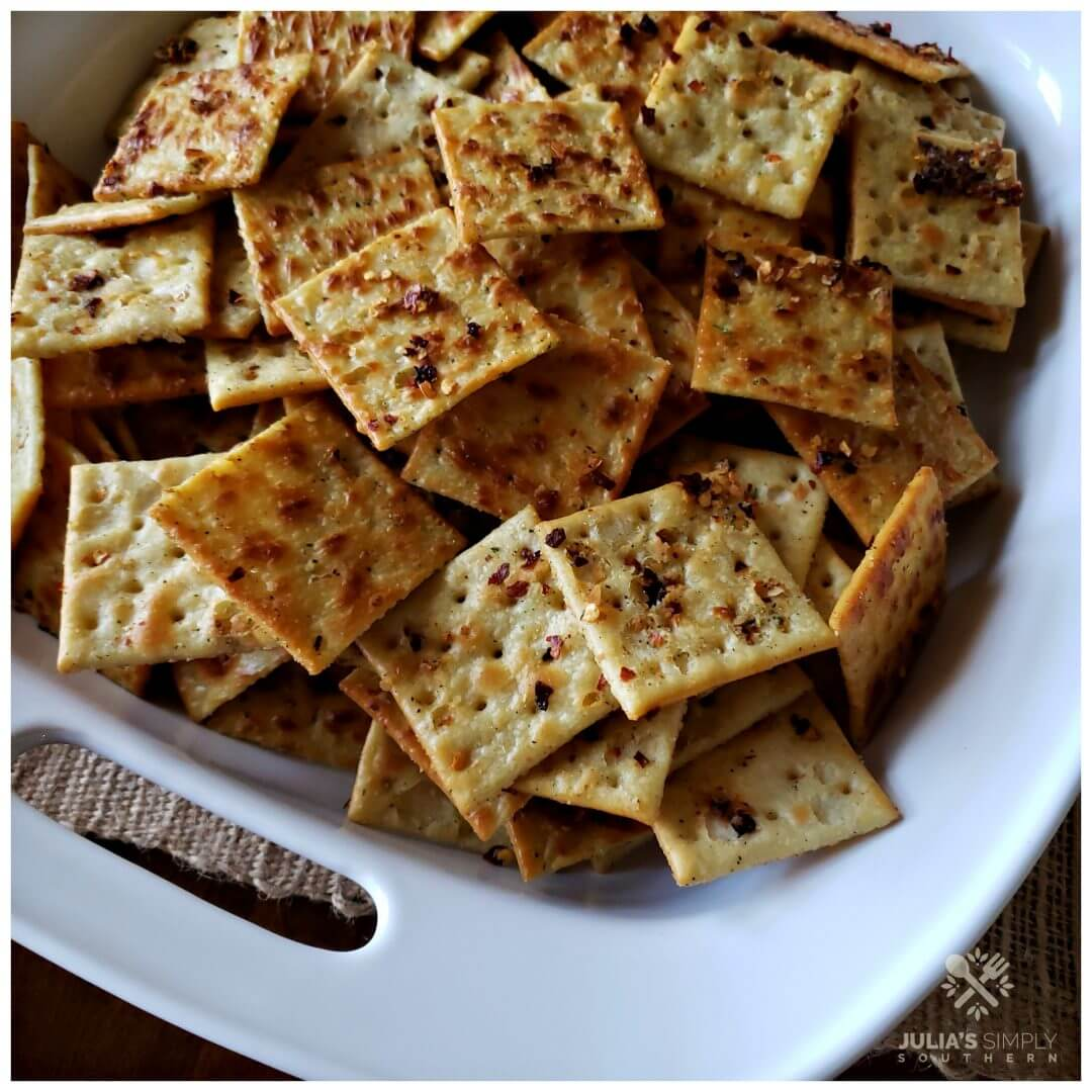 Southern baked seasoned party crackers - Fire Crackers - in a white serving bowl