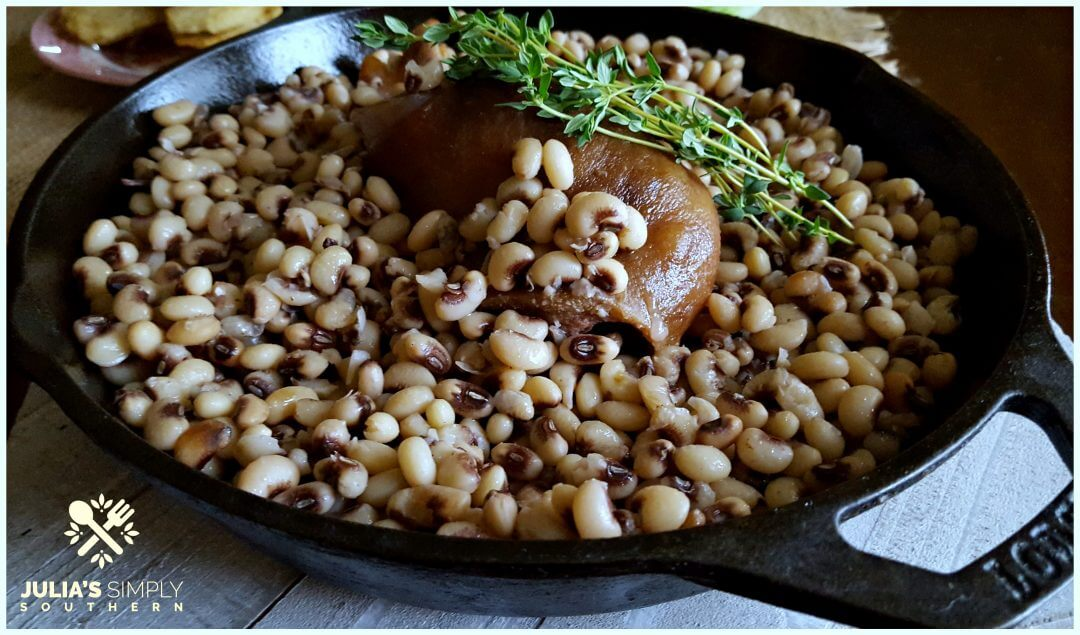 Cast Iron Skillet with Pink eyed peas and a ham hock garnished with fresh Thyme to bring luck in the new year