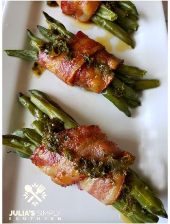 The BEST green bean bundles wrapped in bacon and drizzled with a tangy and delicious sauce