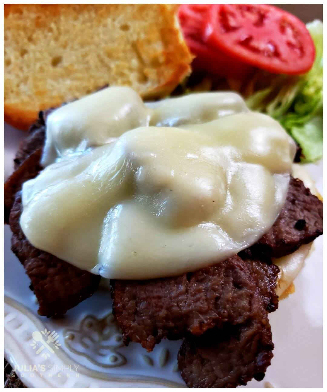 Awesome steak lover sandwich with leftover beef tenderloin and Provolone cheese.