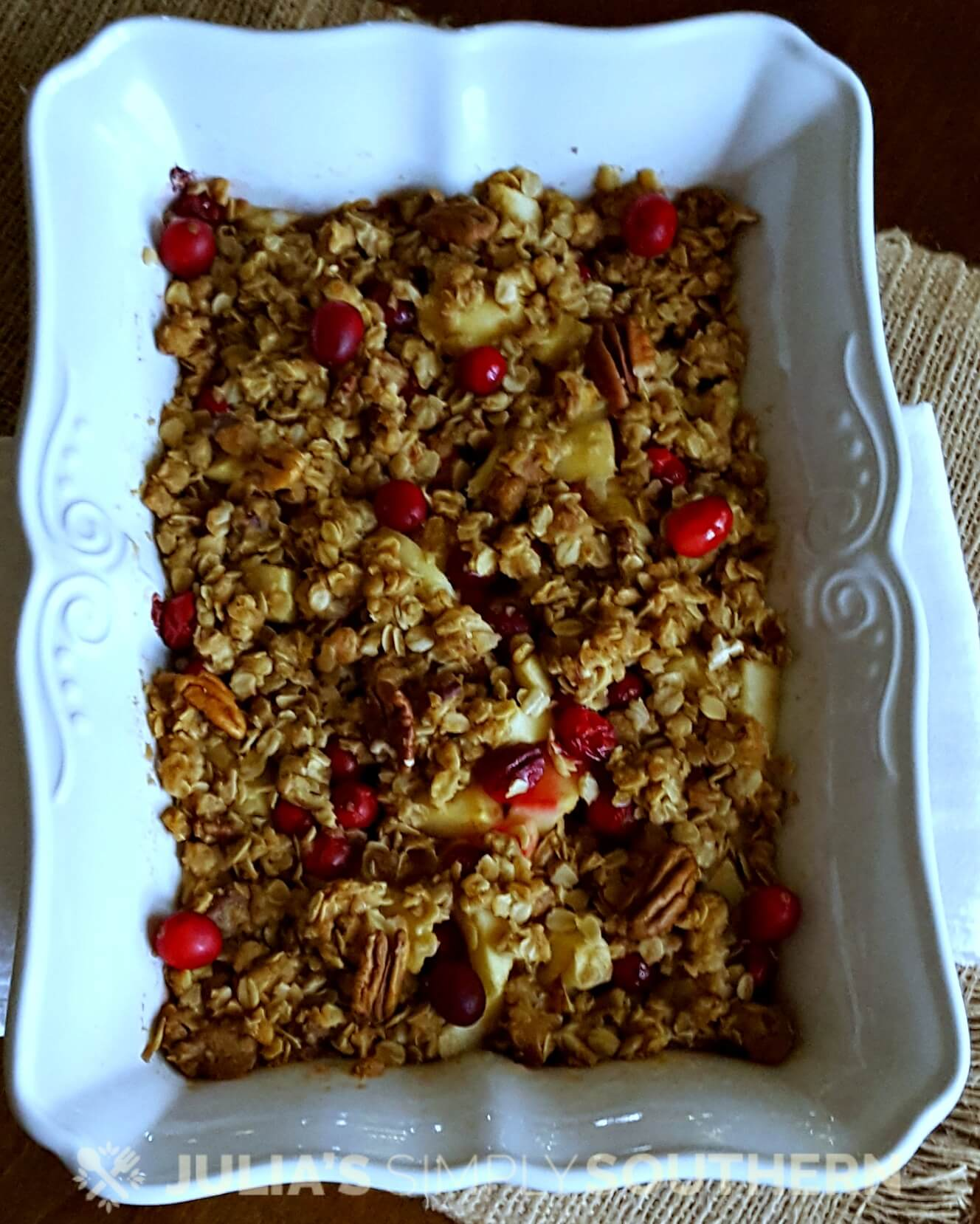 White baking dish with apple cranberry cobbler