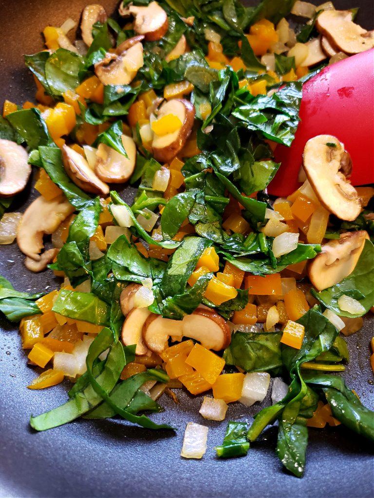 Sautéing vegetables for quiche recipe