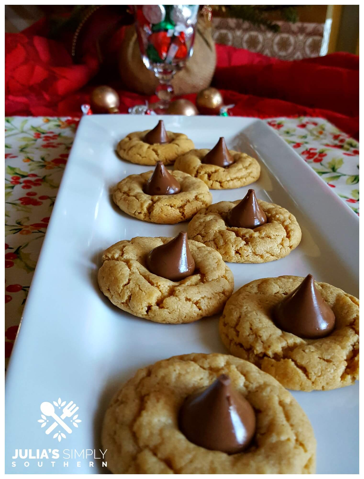 White platter with delicious Christmas cookies - peanut butter blossoms