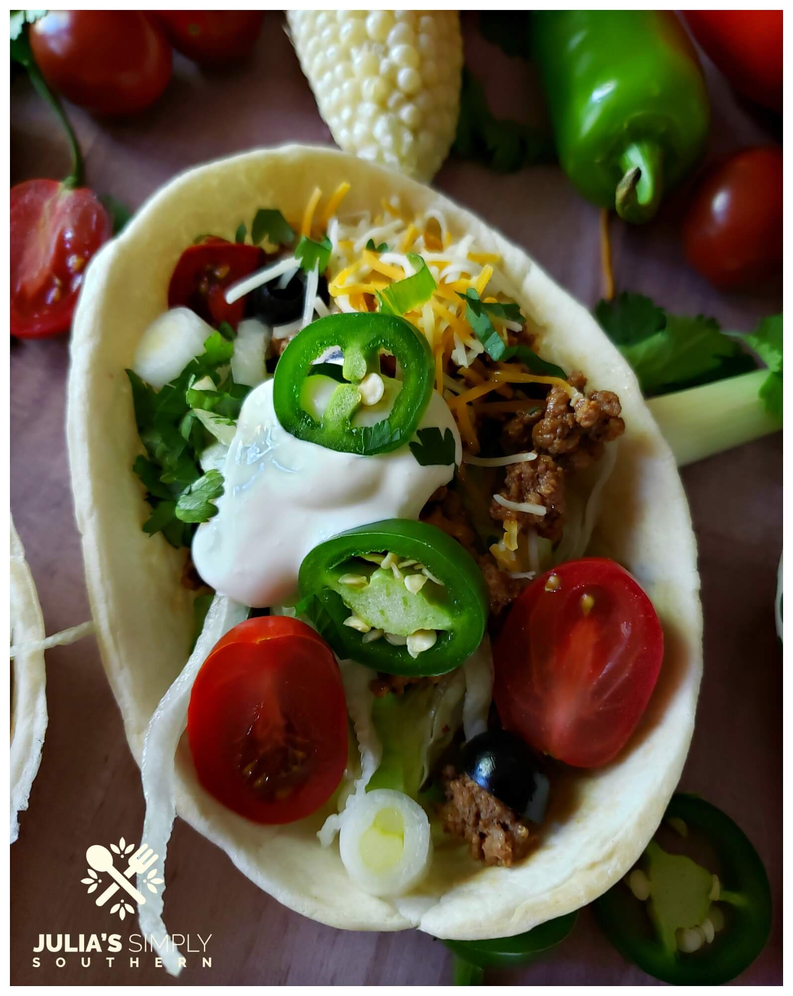 Cinco de Mayo tacos with jalapeno and sour cream