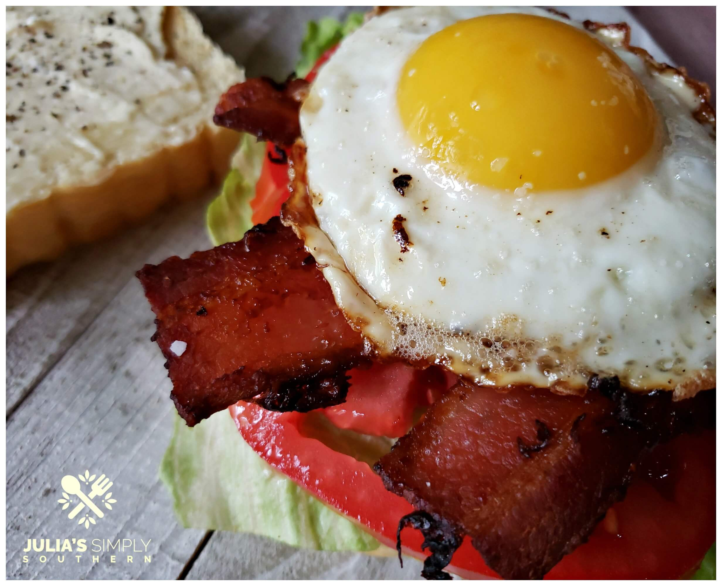 Ultimate BLT sandwich with a fried egg on top and Duke's mayonnaise seasoned with salt and pepper. It is classic delicious times ten!